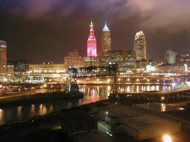 Photo Of Cleveland Skyline At Night, One Of The Three Tallest Buildings  Illuminated Bright Red