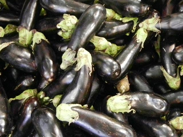 Large eggplant, a shiny purplish black color, with a small light green top