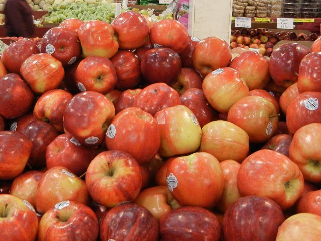 Gala apples, large, red and yellowish with a slight stripey pattern