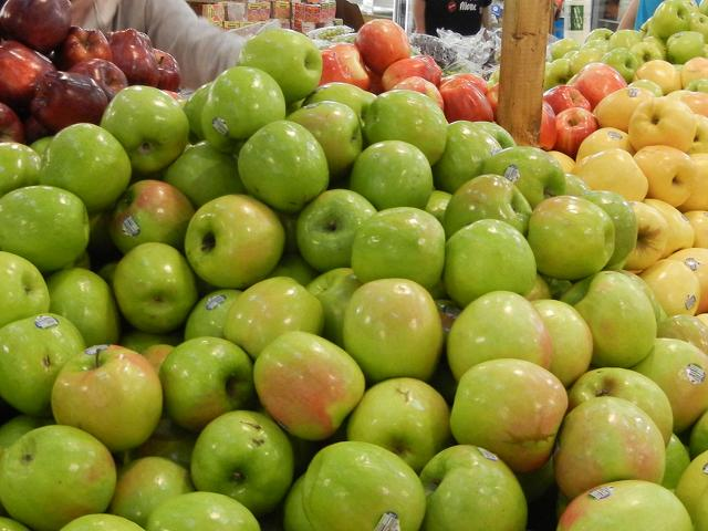 Granny smith apples, bright yellowish green with some pink on them