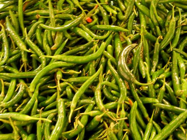 Long, narrow, straight, green chili peppers