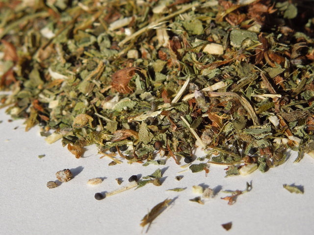 Loose green-leafed holy basil, dried, with large, broken pieces of green leaves, and some brown mixed in