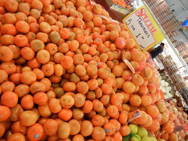 Lots of tangerines, most intense orange, some greenish and a few with bruises