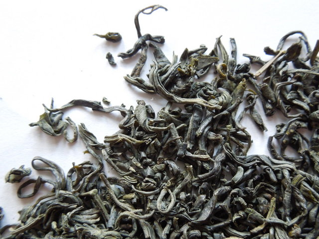 Loose-leaf green tea showing small leaves with a lightly curled shape