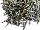 Closeup of loose-leaf sencha, a green tea with straight, thin leaves
