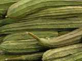Photo of Chinese Okra, a long, green, ribbed, cucumber-shapped vegetable