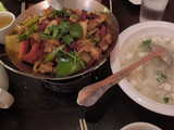 Sichuan dry pot, a colorful dish in a metal bowl, with lots of hot peppers, and a white bowl of seafood tofu soup