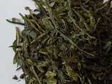 dark green, large, dry tea leaves, broken somewhat