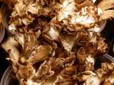 Hen of the woods mushrooms, a crinkly, curly fungus, whitish with brownish edges