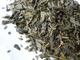 Closeup of green tea broken into small flake-like pieces