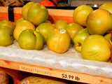 Mango nectarines, green-yellow nectarines, on a shelf with a sign reading: Mango Nectarine - $3.99 lb
