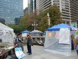 The entrance to the SEPTA station at city hall, Philadelphia, surrounded by tents and people of the Occupy Philly protest
