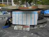 A large whiteboard in a dry fountain, reading: Occupy Philly education and Training Schedule