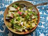 A bowl with a colorful salad containing numerous finely-chopped things