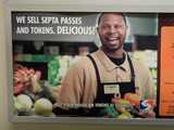 An advertisement showing a supermarket and employee, saying: WE SELL SEPTA PASSES AND TOKENS.  DELICIOUS!  Buy your passes or tokens at Shoprite.