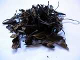 Coarse, large, but delicate-looking, dark brown tea leaves