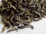 Closeup of high-grade black tea showing twisted leaves with a greenish color and some downy hairs