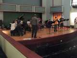 A jazz ensemble on stage, practicing