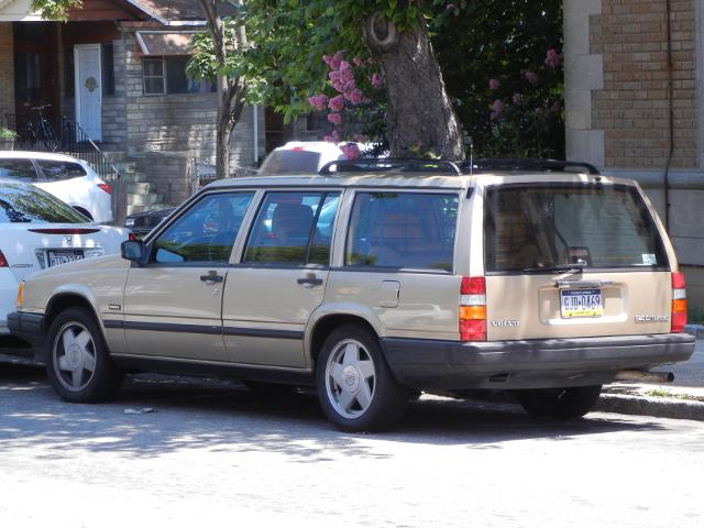 A Beige Volvo Stationwagon 940 Turbo In Good Condition Parked On City Street